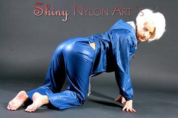 Blonde angel posing in a studio wearing sexy Blue AGU shiny nylon rainwear (Pics)